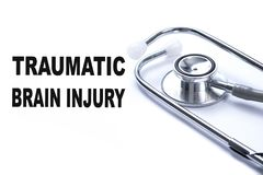 Page with Traumatic Brain Injury on the table with stethoscope,. Medical concept stock image