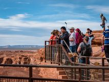 Holiday makers visiting and taking photos of the famous horseshoe bend near Page Arizona Grand Canyon royalty free stock photo