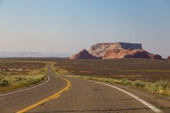Highway runs along the red-sandstone near Page. Page, USA- 02 September, 2017: Highway runs along the red-sandstone near Page, Arizona Stock Photography