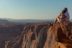 Tourist at Horseshoe Bend on Colorado River in Glen Canyon. Page, USA- 02 September, 2017: Tourist at Horseshoe Bend on Colorado River in Glen Canyon in sunny Royalty Free Stock Photos
