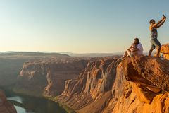 Tourist at Horseshoe Bend on Colorado River in Glen Canyon. Page, USA- 02 September, 2017: Tourist at Horseshoe Bend on Colorado River in Glen Canyon in sunny Stock Photography