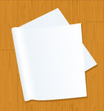 Page on wooden background Stock Photo