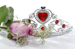 Pageant. Photo of a Pink Rose and Tiara Crown - Beauty Pageant Concept Royalty Free Stock Photos