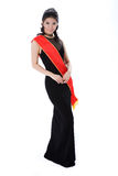 Pageant queen wearing red sash. Woman friendly smile of a pageant queen wearing red sash Stock Photography