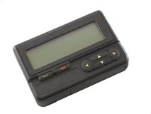 Pager. Used pager isolated over white background stock images