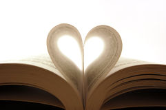 Pages of a book. Curved into a heart shape Stock Image