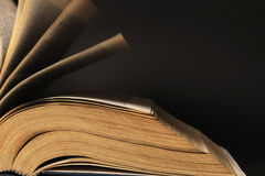 pages of book. Closeup with pages of dictionary  on black background Royalty Free Stock Images