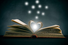 Pages of a book curved. Into a heart shape stock images