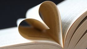 Pages of a book curved into a heart Royalty Free Stock Photography