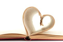 Pages of a book curved into  heart Stock Image