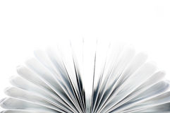 Pages of a book curved into a heart shape. Open book on white background Stock Images
