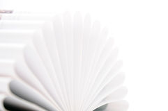Pages of a book curved into a heart shape. Open book on white background Royalty Free Stock Photo