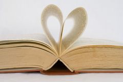 Pages of a book curved into heart shape Stock Photography
