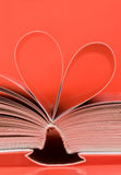Pages of a book curved into a heart shape Stock Photos
