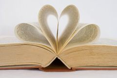 Pages of a book curved into heart shapes Stock Photography