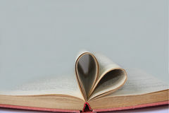 Pages of a book curved into a shape heart Royalty Free Stock Images