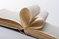 Pages of a book folded in to a heart shape Stock Photos