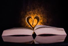 Pages of a book that form a love sign. A creative idea for intellectuals and book readers Stock Photos