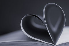 Pages of a book forming the shape of the heart. Royalty Free Stock Images