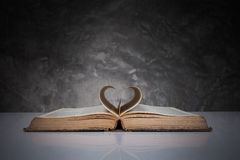 Pages of a book forming the shape of the heart. Stock Photo