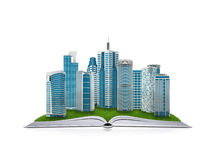 On the pages of an book is grass and skyscrapers Royalty Free Stock Photos