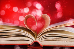 Pages of a book and heart shape