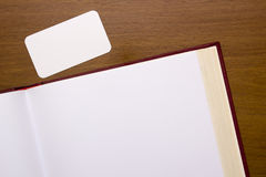 Pages of the book open. To a blank page with a clear card Stock Photo