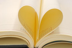 Pages curved into a heart. Book pages curved into a heart Royalty Free Stock Images