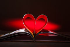Pages curved into a heart shape Stock Photography