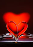 Pages curved into a heart shape Stock Images