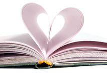Pages of diary curved into heart Royalty Free Stock Images