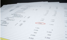 Pages of figures. With a single figure highlighted with red marker royalty free stock images