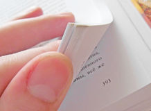 Pages. Flipping through the pages of the book Stock Images