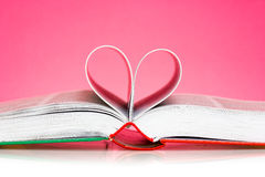 Pages folded into a heart shape Stock Photo