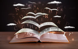 Pages and glowing letters flying Stock Images