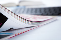 Pages of journal and keyboard close-up Stock Photography