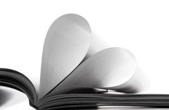Pages of love. Pages in the book bent in the form of heart Royalty Free Stock Image