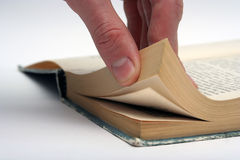 Pages of the old book. Male hand holding the pages of the old book Royalty Free Stock Photo