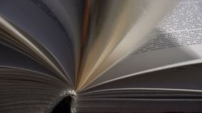 Pages of opened book on wind. Pages of opened book on a wind stock video footage