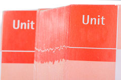 Pages of red school book with space for unit`s number Stock Image