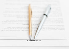 Pages of sales agreement and two pens Stock Photos