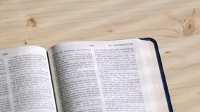 Pages turn by themselves in new testament stock video