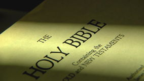 Pages turning in a holy bible stock video footage
