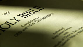 Pages turning in a holy bible stock footage