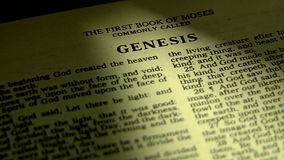 Pages turning in a holy bible, to book of genesis stock video