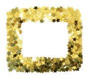 Pagina con le stelle d'oro della stagnola Confine sparso delle stelle Struttura sventata naturale Immagini Stock