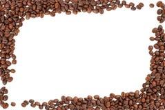 Pagina dei chicchi di caffè su bianco Fotografia Stock