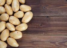 Pagina delle patate su vecchio legno II Immagine Stock
