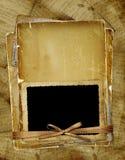 Paginación vieja con el marco para la foto. Cintas y arqueamiento. Foto de archivo