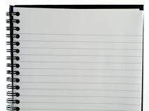 Paginación alineada blanca llana del cuaderno de Ringbound del papel Imágenes de archivo libres de regalías